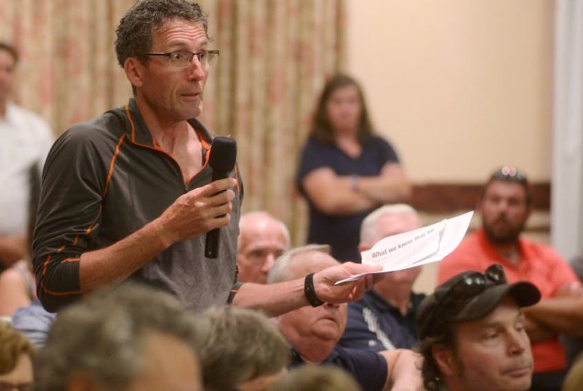 Tim Mair, a Georgetown resident who also owns property in the unincorporated area outside the town, asks a question during a meeting on the Three Rivers amalgamation last night. The meeting resulted in residents of the unincorporated areas of Georgetown Royalty and Burnt Point signing a petition to form a new resort municipality.
