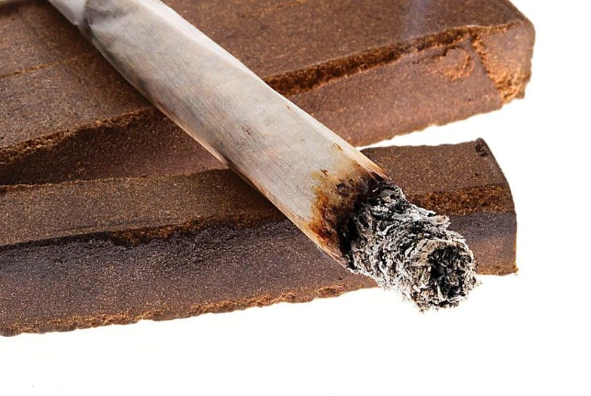 FILE PHOTO: Picture of a lit joint laid on two pieces of hashish. The photo is not from the case mentioned in the story and is for illustration only.