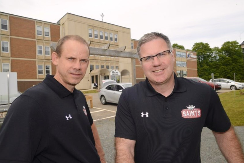 Kenny MacDougall, right, headmaster, and Stephen Champion, director of curriculum development, are busy preparing to open the Mount Academy this fall in Charlottetown.