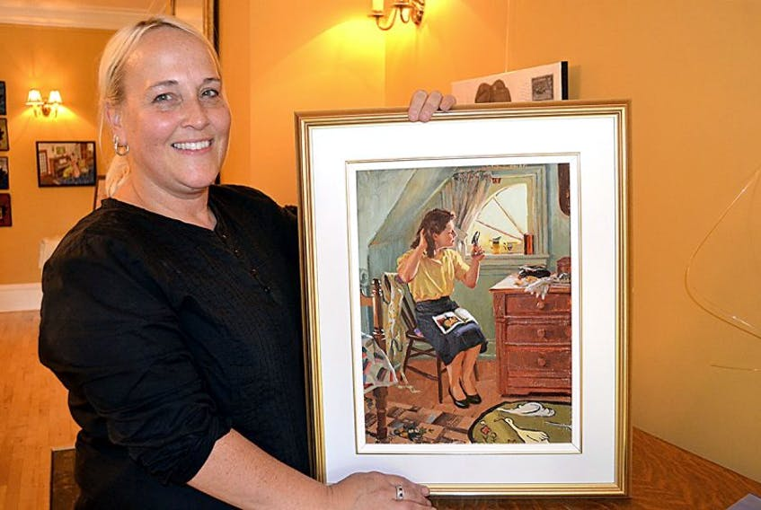 """Culture Summerside manager Lori Ellis holds """"The Girls Day Off"""" by Grace Curtis. It's one of the paintings in the 150th anniversary exhibition on display at The Lefurgey Cultural Centre in Summerside until the end of September."""