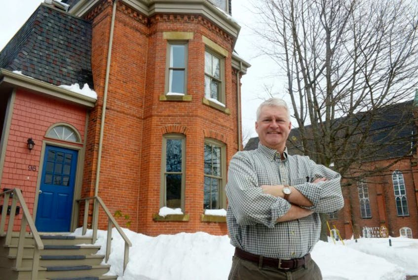 Angus Orford stands outside his heritage property, the Houle House at 96 Prince Street. Orford and Karen Rose received a heritage award from the city after performing a number of renovations to the property while keeping its historical aspects. Orford also thanked a number of contractors and construction companies who helped with the many enhancements to the home.