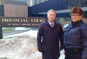Charlottetown police Deputy Chief Brad MacConnell and RCMP Sgt. Leanne Butler stand outside the provincial courthouse Wednesday in Charlottetown after Richard Joseph Arsenault was sentenced to nine years in prison.