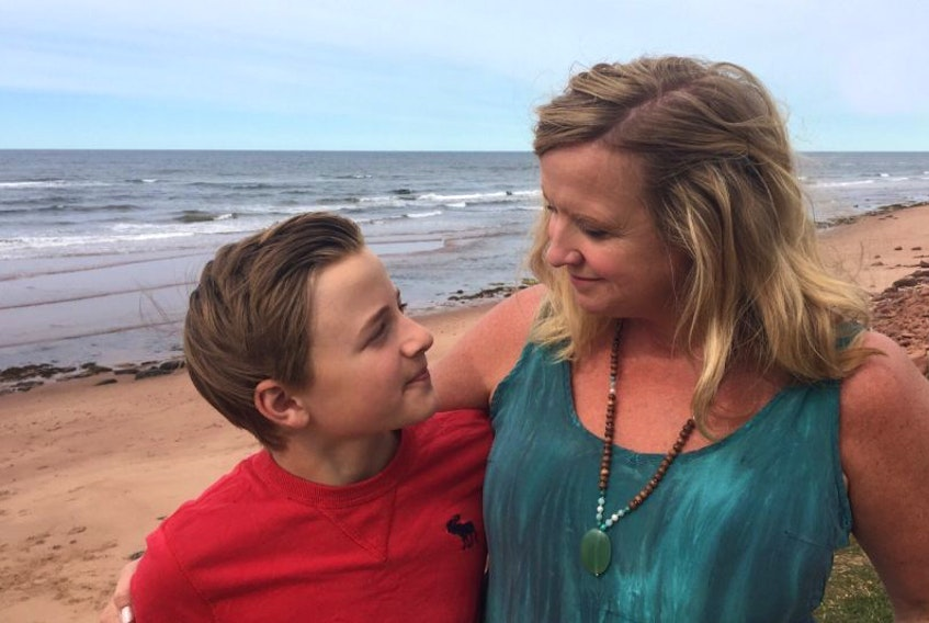 Beth Johnston and her son, Charlie Ross, are shown on the beach in Savage Harbour Monday where they had the fright of their lives Saturday evening after getting caught in a rip current.