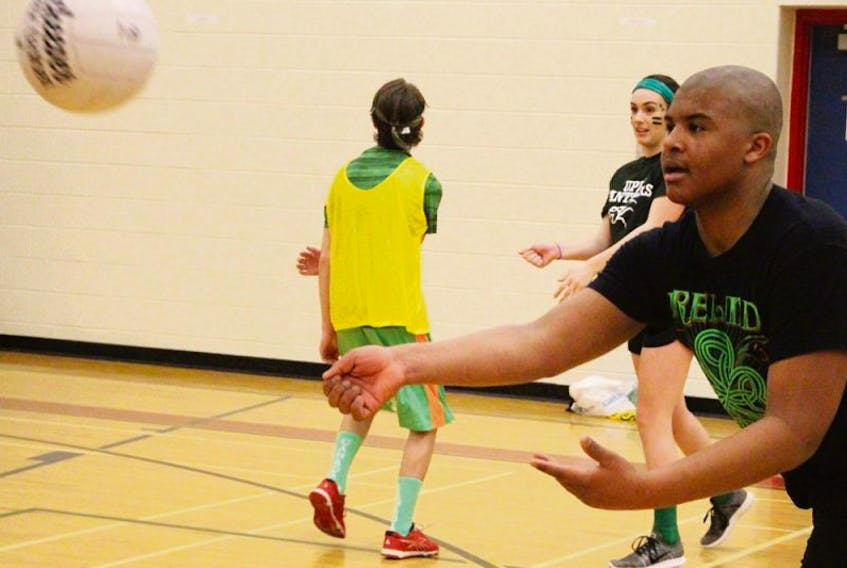 George Madumba practises passing during a Gaelic football drill at Athena Consolidated School in Summerside. Recently, Grade 9 students learned the rules and how to play the Irish sport.