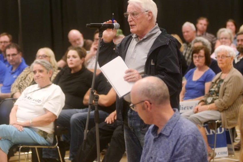 Ken Williams asks a question during last night's Progressive Conservative leadership forum at Murphy's Community Centre. Candidates James Aylward and Brad Trivers will face each other in one more forum in Brudenell before the party announces its new leader on Friday, Oct. 20.