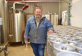 Eric Wagner with brewing equipment at his Prince County microbrewery. The brewery is now open and selling beer to the public.