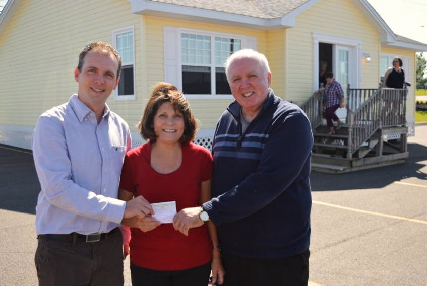 Louise Coneen of Charlottetown was the lucky winner of the Big Brothers Big Sisters of P.E.I. cottage draw on Friday. Helping out with the draw were Myron Yates, right, executive director of the organization, and board member David Green.