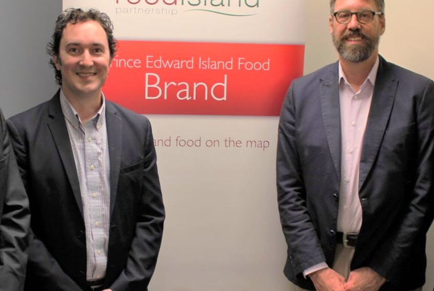 John Rowe, left, and Bryan Inglis are shown at a meeting in Charlottetown Friday that focused on the role food plays in Atlantic Canada's economy.