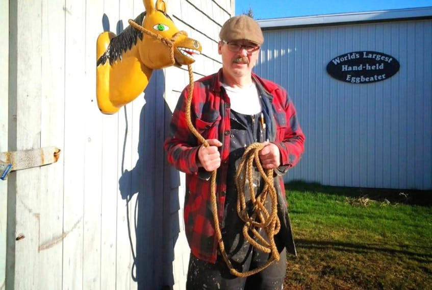 Kerras Trent Jeffery appears next to one of his pieces of folk art. The native of Alma, P.E.I., died on June 1.