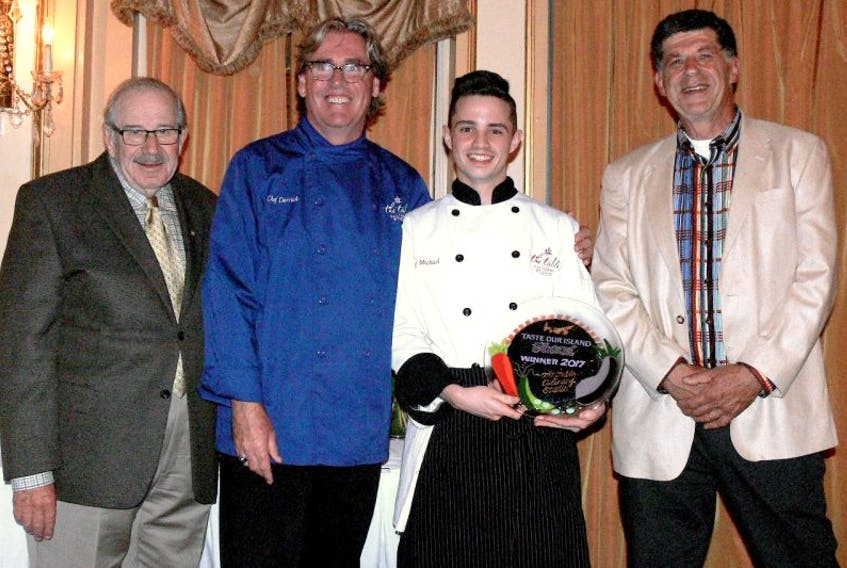 P.E.I. Adapt Council chairman Elmer MacDonald, left, and executive director Phil Ferraro, present the 2017 Taste Our Island Award to chef Michael Bradley of The Table Culinary Studio at the Roving Feast at the Charlottetown Hotel. Second left is Derrick Hoare, owner of The Table Culinary Studio.