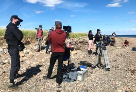 Cast and crew prepare for a scene in director and writer Shelley Thompson's first feature, Dawn, Her Dad and the Tractor. The Nova Scotia film recently became the first local feature to complete shooting under the health guidelines required by the COVID-19 pandemic.