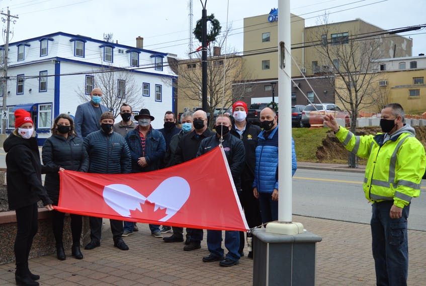 A small group comprised mostly of CBRM councillors gathered at the flag poles outside the civic centre in Sydney to acknowledge the internationally recognized Giving Tuesday. Among those attending were United Way of Cape Breton executive director Lynne McCarron, far left, and councillor Steve Gillespie, third from the right, who read the CBRM proclamation in recognition of Giving Tuesday. DAVID JALA • CAPE BRETON POST
