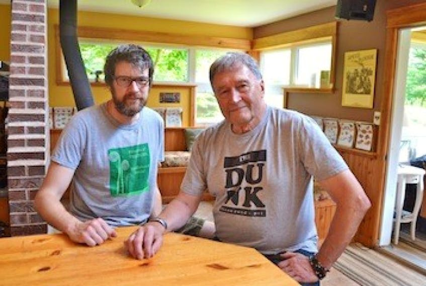 Jeff (Jethro) Stewart, left, and Hal Mills take a break from planning Sunday's Fiddlehead Social at The Dunk in Breadalbane. It's the final social at the venue because Mills is selling the house at the end of the summer.