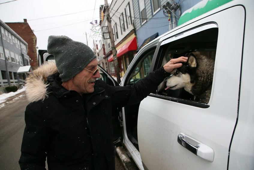 Ray Cyr pets his dog, Peska, after making a stop on Water Street in Pictou on Thursday. Now retired, Cyr was a boilermaker at the Northern Pulp mill for 32 years.