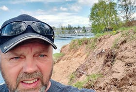 Part of Clyde Compton's Pine Tree Drive property in Deer Lake is dropping into the Humber River as high water levels erode the riverbank.