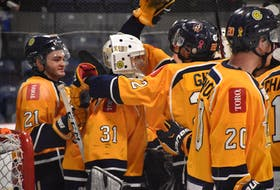 The Yarmouth Mariners congratulate their goalie Justin Sumarah on his 4-0 shutout over Pictou in the team's final regular season game. TINA COMEAU PHOTO