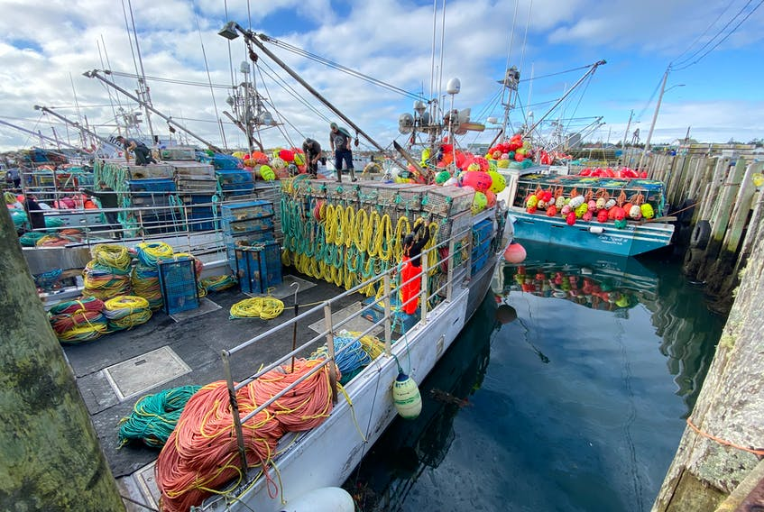 Lobster traps are loaded onto a boat at the Pinkney's Point, Yarmouth County, wharf in late November. TINA COMEAU PHOTO