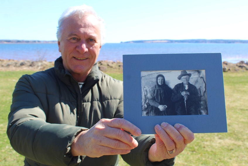 Acadian historian Georges Arsenault holds a photo of his maternal grandfather's grandparents, Léon Poirier and Marie Bernard. they were married in Tignish in 1846 and had 16 children, six of whom died in infancy. In 1915, they celebrated their 69th wedding anniversary, and Léon died later that year at the age of 96. He was a great-grandchild of Pierre Poirier.