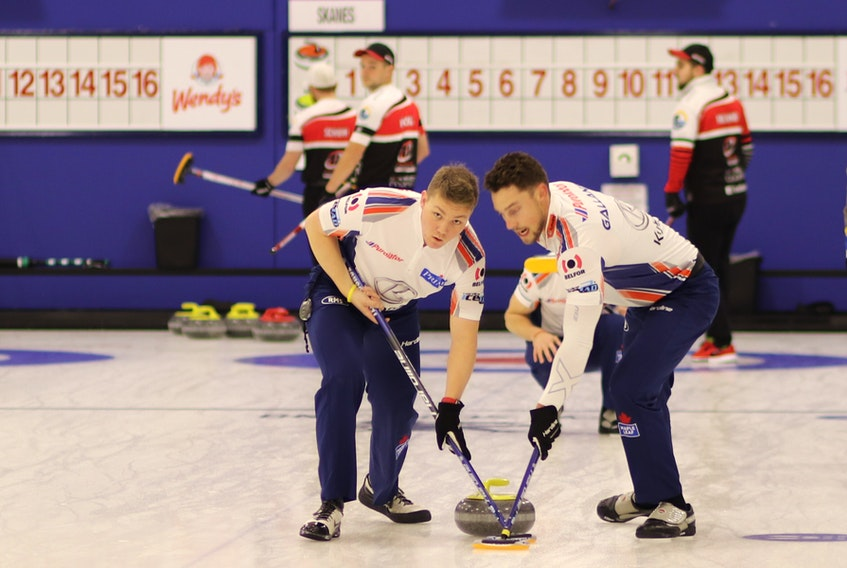 Ryan McNeil Lamswood (left) and Brett Gallant sweep a shot for Team Gushue during a game at the 2020 Stu Sells 1824 Halifax Classic last fall. McNeil Lamswood filled in for regular lead Geoff Walker, providing skip Brad Gushue, third Mark Nichols and Gallant a chance to assess the young men they would eventually choose as their alternate for the 2021 Brier. — Contributed