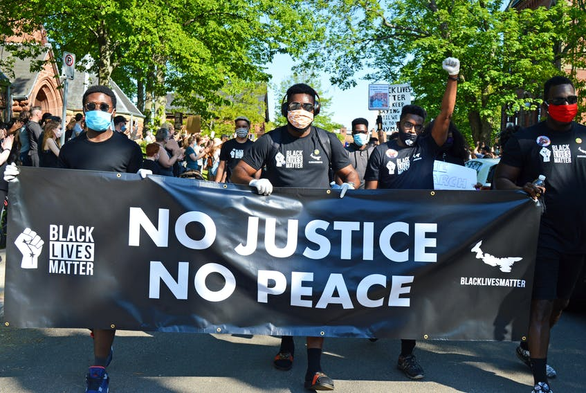 Thousands of people took part in a peaceful Black Lives Matter march in Charlottetown on Friday. After gathering on the Richmond Street side of the Coles Building, participants of all ages began pouring out onto Grafton Street at 5:05 p.m. – so many that it took almost 30 minutes for everyone to begin marching. With the assistance of Charlottetown Police Services, the march wound its way through the streets and ended near the provincial government buildings. The march was held following an outcry over black lives lost in Canada and the U.S., including George Floyd and Regis Korchinski-Paquet. For more coverage on the march, go to www.theguardian.pe.ca and see Monday's Guardian.