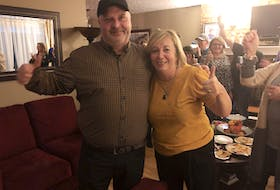 Darren O'Quinn celebrates winning the District 11 seat with his wife Nancy and supporters gathered at this house in New Waterford on Saturday evening.