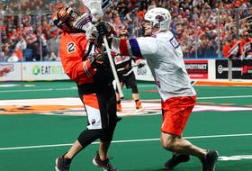 Halifax Thunderbirds defender Graeme Hossack, right, gets his stick up on Buffalo Bandits forward Chris Cloutier during a National Lacrosse League game in Buffalo, N.Y., on Saturday. (HALIFAX THUNDERBIRDS)