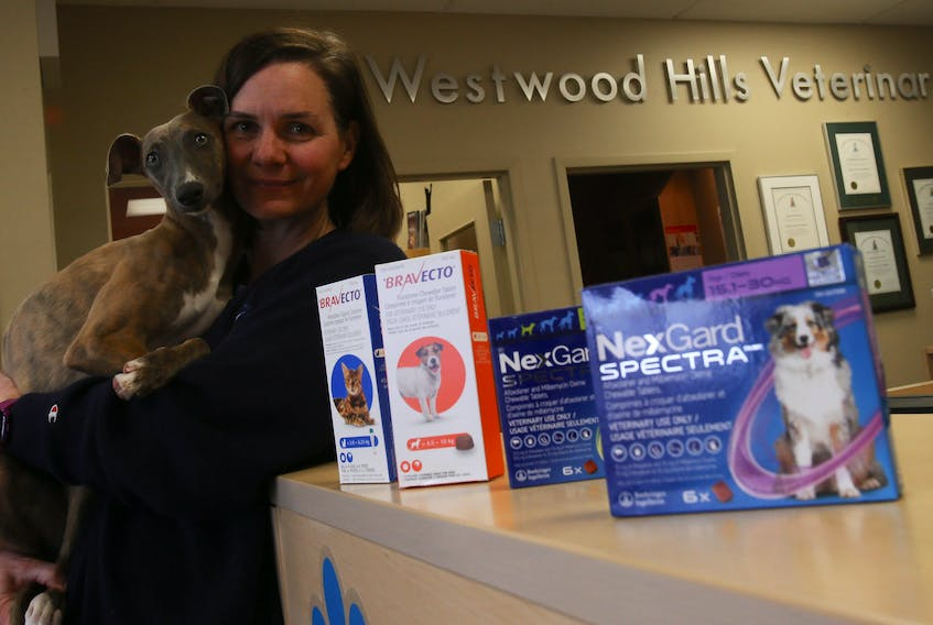 Dr. Jane Corkum and one of her patients, Pepper, are seen with some various tick medicines at her Westwood clinic in Upper Tantallon on Tuesday. TIM KROCHAk/ The Chronicle Herald