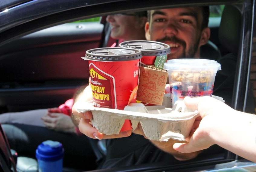 Drive-thru customers have become a lifeline for Tim Hortons this year while dine-in restrictions are in place.