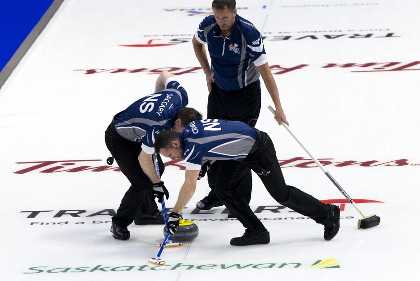 Nova Scotia third Paul Flemming watches  second Scott Saccary and lead Phil Crowell sweep at the 2018 Tim Horton Brier. Michael Burns