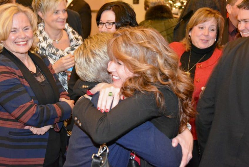 Tina Mundy hugs a supporter following her election as the Liberal candidate in District 22, Thursday night. Colin Maclean/Journal Pioneer