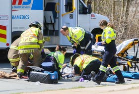 Halifax firefighters and EHS paramedics, attend to a cyclist who was struck by a vehicle on Cleary Street at Alderney Drive in Dartmouth on Tuesday, May 7, 2019.