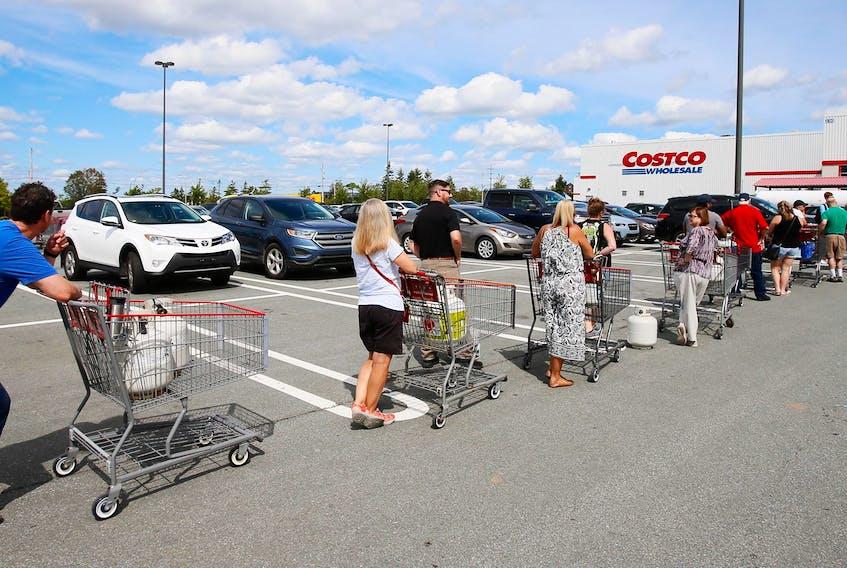 Customers line up for propane at Costco Bayer's Lake, as Nova Scotians prepare for hurricane Dorian.