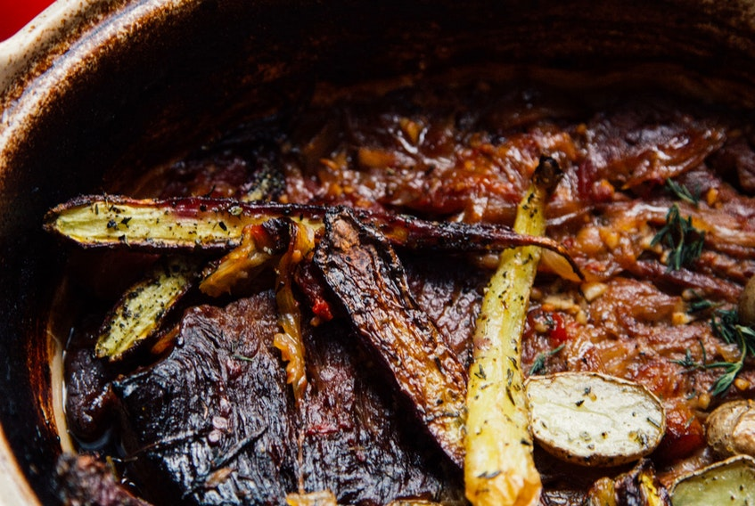 Mark DeWolf puts his own spin on the classic pot roast, one of Nova Scotia's most traditional family meals.  UNSPLASH/CHARLES DELUVIO
