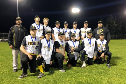 Pasadena Pirates coach Greg Whelan, left, is seen here with his Under-18 team. He has coached most of the players on this team since they were in T-Ball. CONTRIBUTED