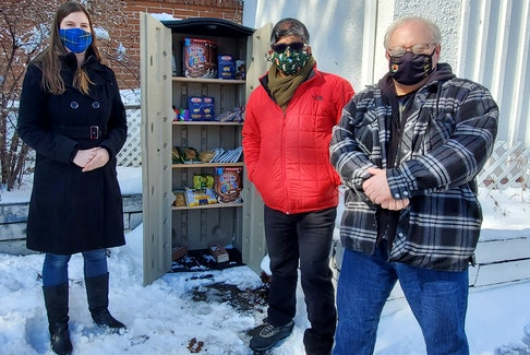 From left, Nicole Mosher, Fairview Resource Centre board member Mohammad Ehsan and initiative co-organizer Dave Aalders stand at the newly launched community food cupboard in Fairview. Two have been installed, one at the Fairview Resource Centre and another at Al-Barakah Mosque. CONTRIBUTED