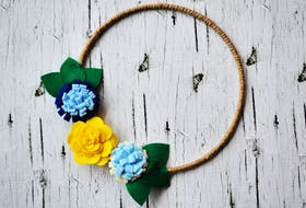 Trying new routines and crafts can help get over the winter/February blues. Gina Bell recently created this spring felt flower wreath.  CONTRIBUTED