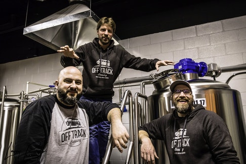 Instead of viewing down time caused by COVID-19 restrictions as a negative, Off Track Brewing co-owners Allan MacKay, left, Jon Saunders, centre, and Matt Scott used it as an opportunity to make renovations and expand their indoor space. Larry Peyton Photography