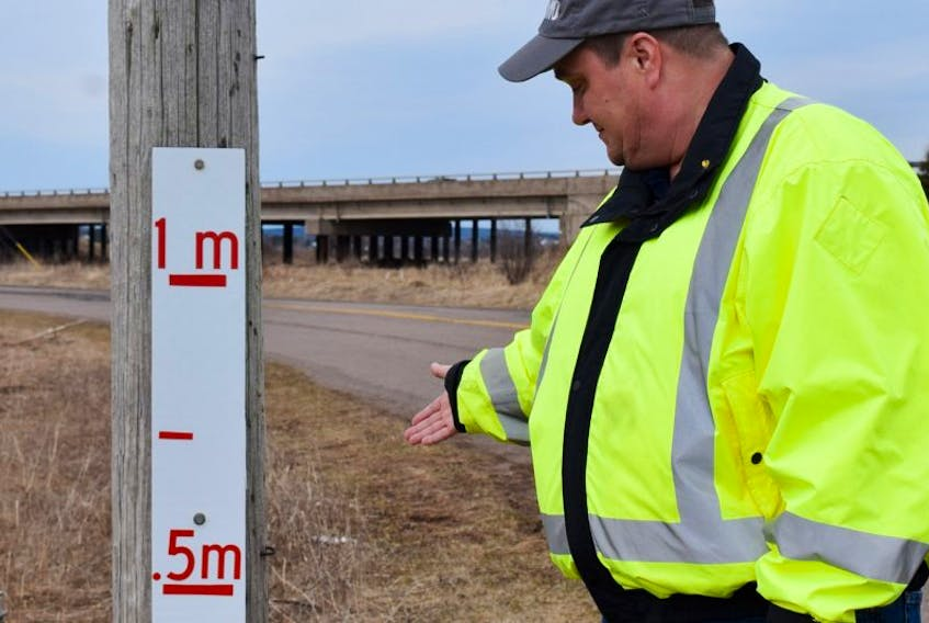 David Westlake says signs were installed on Tidal Bore Road as a way to determine water levels during flooding conditions.