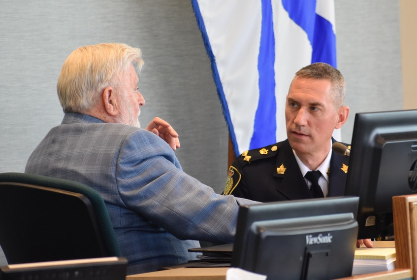 Acting police chief Robert Walsh of the Cape Breton Regional Police Service speaks with Coun. Jim MacLeod in the Cape Breton Regional Municipality council chambers at the civic centre in Sydney in this file photo. CAPE BRETON POST