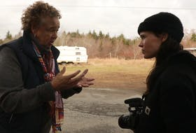 Shelburne's South End Environmental Injustice Society (SEED) founder and president Louise Delisle is shown talking with director Ellen Page in a photo promoting the release of the documentary, There's Something in the Water. FROM ONLINE