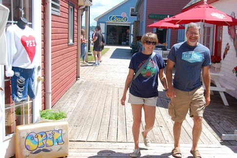 Cindy Mitton and Derek Brown of Fredericton took advantage of the first day of the Atlantic bubble to visit P.E.I. The couple enjoyed a stroll around Charlottetown including a trip to Peakes Quay Marina before going to the Trailside Cafe to take in Nick Doneff's performance.