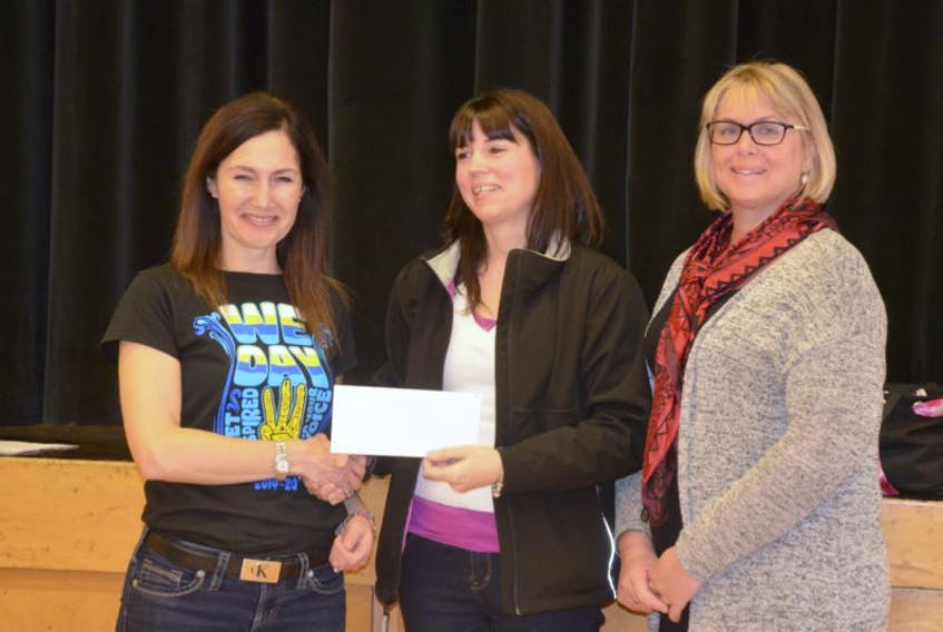 """Evangeline Middle School teacher Freda Larade, left, presents a cheque to Sandra White and Cindy Ueffing of the Kids Action Reach Program, for $217.77, half the proceeds from candy cane sales as part of the EMS Tree of Hope campaign. During November and December, the school'sexploratory and leadership groups encouraged students to share with children who need our help to celebrate the holiday season. """"We believe this is a great opportunity to reflect that the holidays are for sharing as well as receiving. The funds raised, and the gift items donated, were split between the Kids Action Reach Program and Chrysalis House."""
