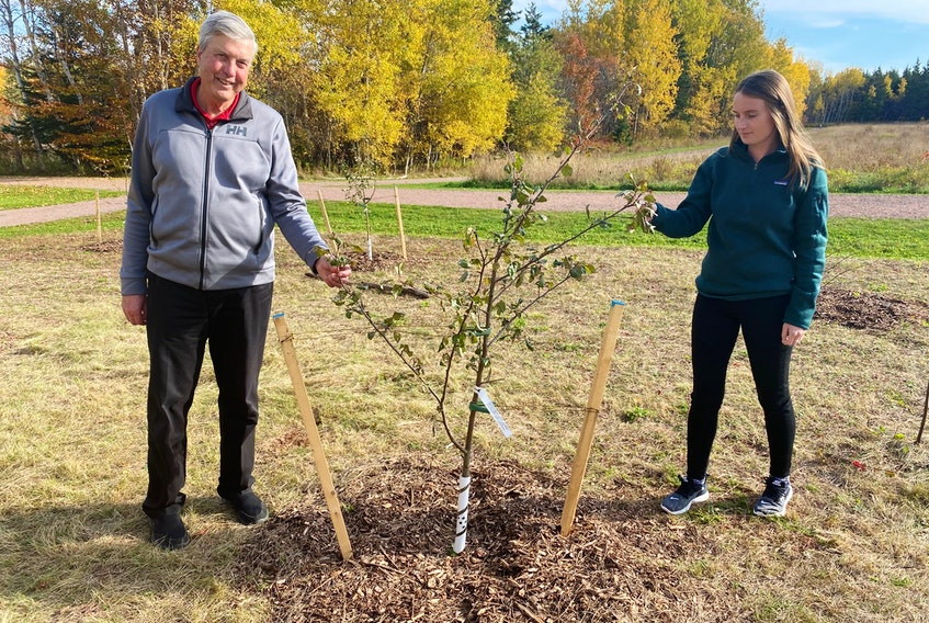 Stratford Mayor Steve Ogden and Emily Vanlderstine, co-ordinator of the Stratford Area Watershed Improvement Group, were among those who helped plant the trees that are part of the edible orchard at Fullerton's Creek Conservation Park.