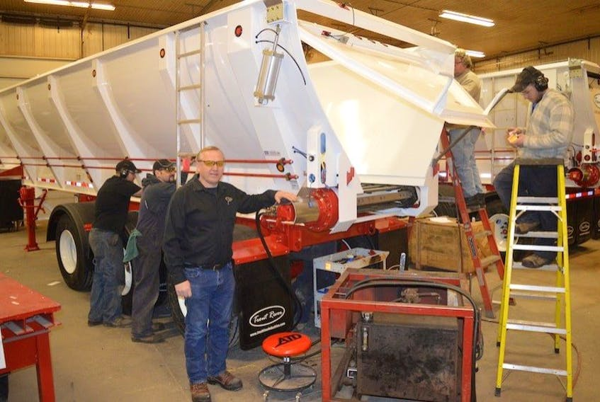 ['Trout River Industries owner Harvey Stewart oversees the manufacturing of trailers in his company's production area in Carleton ion western P.E.I. Those live-bottom trailers are destined for road-building work in western Canada.']