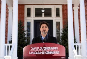 Prime Minister Justin Trudeau speaks at a press conference about COVID-19 in front of his residence at Rideau Cottage on the grounds of Rideau Hall in Ottawa, on Sunday, March 22, 2020.