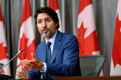 """Prime Minister Justin Trudeau speaks during a news conference on Parliament Hill on Sept. 25, 2020. A public global credit agency has issued a warning about """"the deterioration of Canada's public finances."""""""