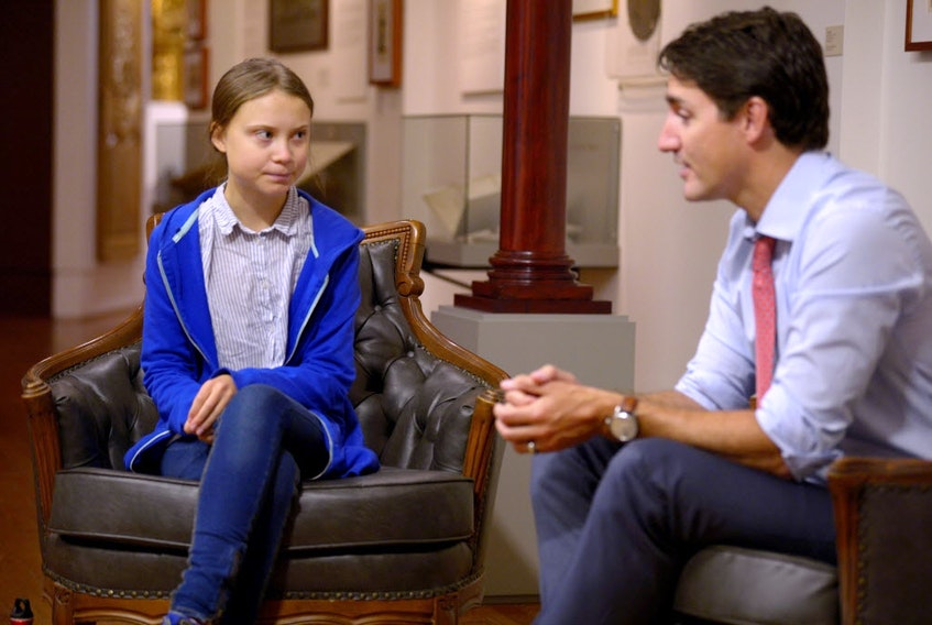 Prime Minister Justin Trudeau greets Swedish climate change teen activist Greta Thunberg before a climate strike march in Montreal on  Sept. 27, 2019.