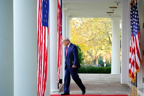 """In this file photo US President Donald Trump arrives to deliver an update on """"Operation Warp Speed"""" in the Rose Garden of the White House in Washington, DC on November 13, 2020."""