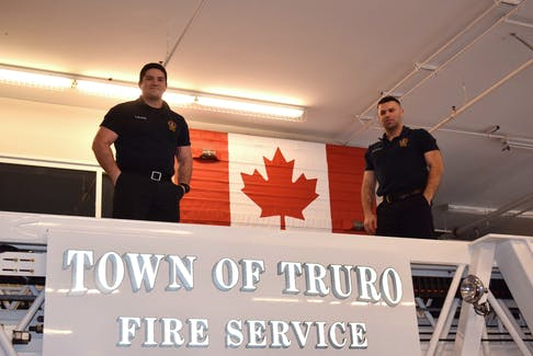 Errison Blackie is proud of his buddy Mitchell Shewfelt's efforts to decorate Truro's fire hall. From left, Errison Blackie and Mitchell Shewfelt. FRAM DINSHAW/TRURO NEWS