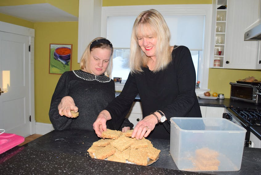 Claire Sangster, left, and her mother Kelly Mercer have raised more than $1,000 in oatcake sales to support the Colchester Community Workshops Foundation's building expansion. FRAM DINSHAW/TRURO NEWS